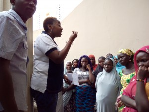 Sesor's Executive Director, Ier JonathanIchaver, addressing the women while a Sesor representative interprets