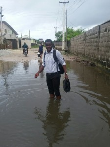 Sesor's Programme Officer, Rendrix Berepele, braving the flooded areas to follow up with the women