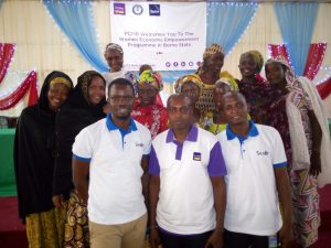 Some of the happy women with Sesor's Programme Officers and Mr Rafiu Mohammed